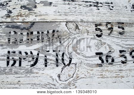 Texture of old grey color vintage wood background with cyrillic inscriptions. Wood texture with natural pattern. A part of wooden boxes for transport.