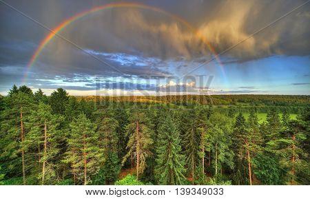 Rainbow on the horizon after the rain.