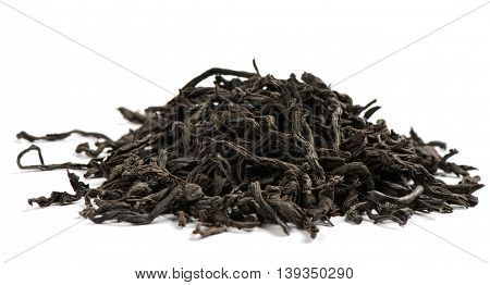Dry black tea leaves on white background.