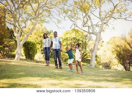 Happy family walking together at park