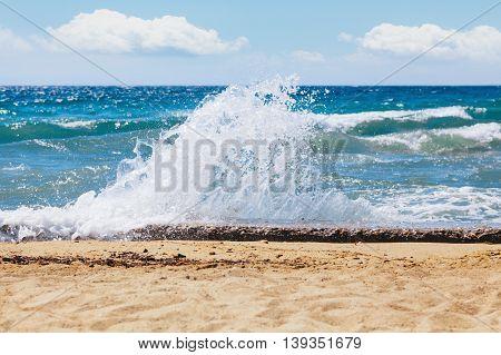 Waves breaking on rocky coast, seaside concept