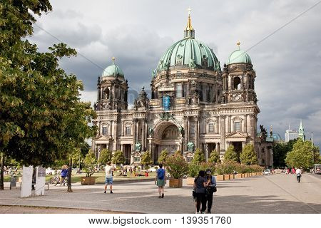 Berlin, Germany - July 1, 2016: Streetview of the Berliner Dom in Berlin with a cloudy sky. It's a traditional old Berlin Cathedral.
