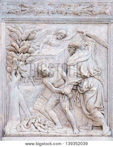 BOLOGNA, ITALY - JUNE 04: Abraham Sacrificing Isaac, relief on portal of Saint Petronius Basilica in Bologna, Italy, on June 04, 2015