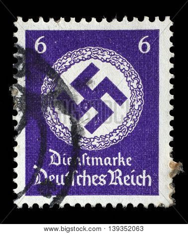 ZAGREB, CROATIA - JUNE 22: A postage stamp printed in Germany shows the Swastika in an oak wreath, circa 1943, on June 22, 2014, Zagreb, Croatia