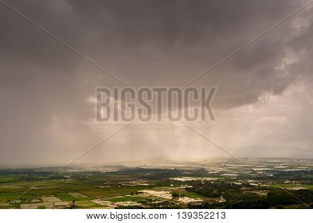 Rain Curtaining A View Of The Mountains.rain Storm Over Rice Fields With Curtain Of Rain.