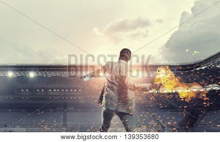Businessman throwing petrol bomb . Mixed media