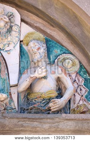 LUCCA, ITALY - JUNE 06, 2015: Saint on the portal of the Saint Joseph church in Lucca, Italy, on June 06, 2015