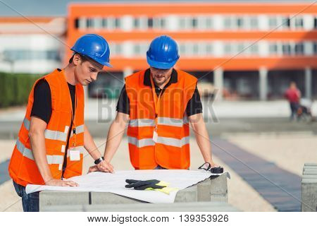 Construction workers on meeting on construction site