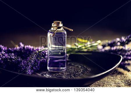 Lavender oil in a glass bottle, studio shot