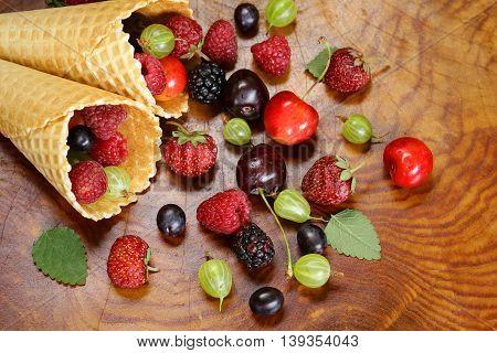 various fresh organic berries in waffle cone ice cream