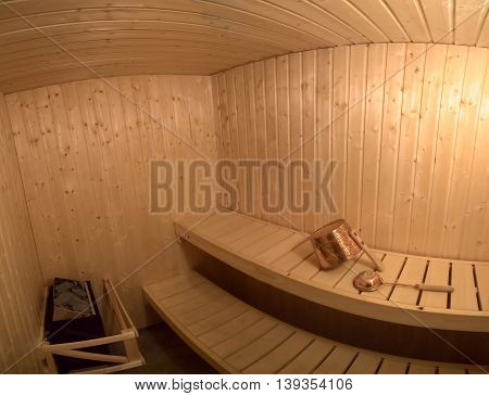Wide angle shot of a typical Swedish sauna.