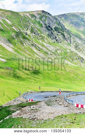 Tranalpina mountain road in Romania in summer with the hairpins of it's highest point Urdele Pass