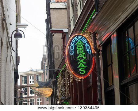 AMSTERDAM NETHERLANDS - NOVEMBER 15 2015: neon sign of a coffee shop in an amsterdam alley