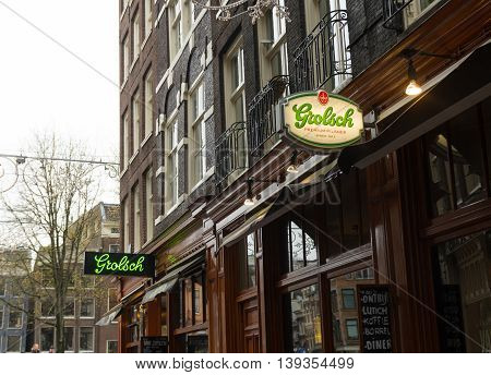 AMSTERDAM NETHERLANDS - NOVEMBER 15 2015: Grolsch beer brand sign in amsterdam. Since 2016 Grolsch in owned by Japanese Asahi