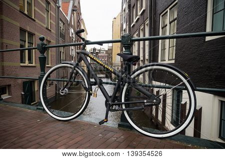 AMSTERDAM NETHERLANDS - NOVEMBER 15 2015: Bicycle for borrow belonging to the student hotel a specialized long or short term stay hotel for students