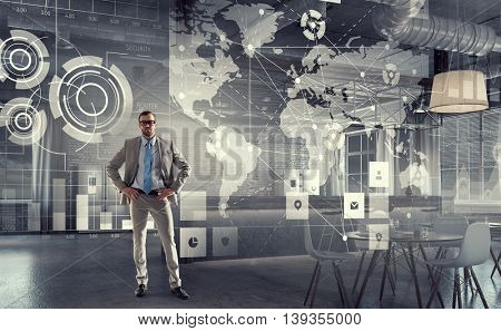 Businessman in modern office . Mixed media