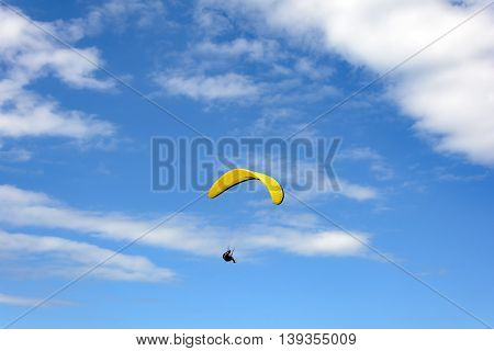 Paragliding flight on the hill Lighthouse in Torres city Rio Grande do Sul