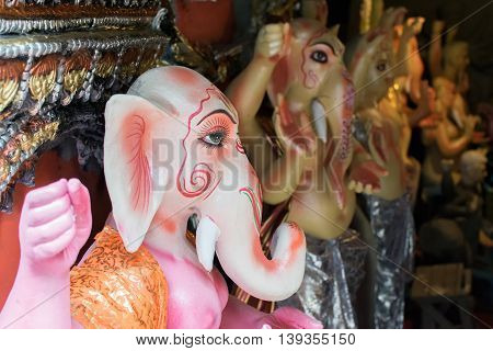 KOLKATA WEST BENGAL INDIA - 13 SEPTEMBER 2015: Beautiful fresh painted clay idol of Lord Ganesha at Kumartuli as preparation for