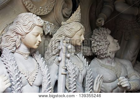 KOLKATA WEST BENGAL INDIA - 13 SEPTEMBER 2015: Clay idol of Lord Kartik Goddess Laxmi and Asura (demon) being prepared for