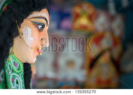 KOLKATA WEST BENGAL INDIA - 13 SEPTEMBER 2015: Clay idol of Goddess Durga is being prepared for