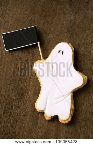 Halloween white ghost holding panel, close up