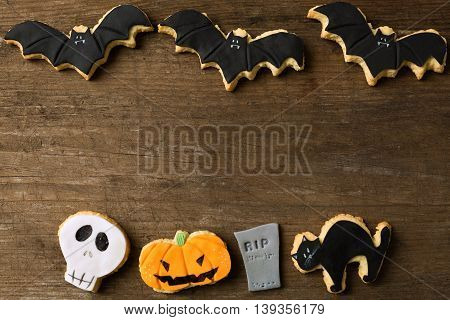 Halloween Cookie Background on retro wood, close up