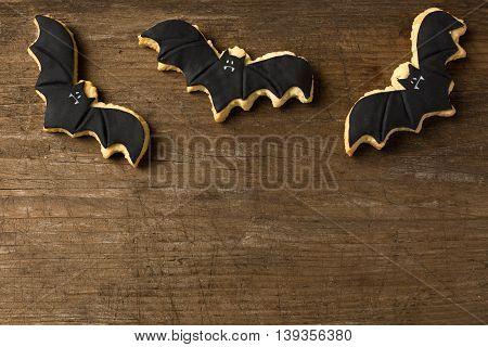 Three Bat Flying On Wood Background