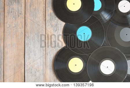 Vinyl records on top of wood with space for text