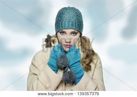 beautiful girl in winter fashion clothes on backgrounf