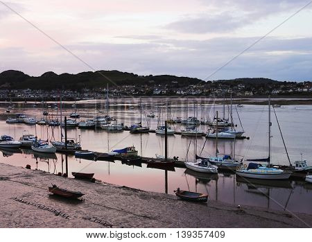 CONWY, WALES, JUNE 27: Conwy River on June 27, 2016, in Conwy, Wales. The River Conwy harbors a fleet of boats as the lights come on in Deganwy Wales.