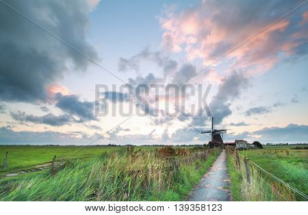 bike road to Dutch windmill in the morning Netherlands