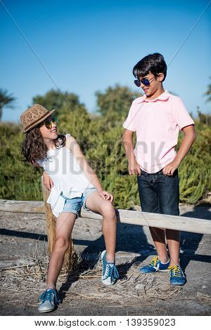 Young boy and girl lead the conversation