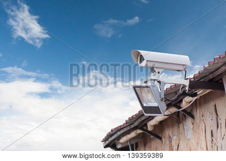the street camera of external supervision hanging at the corner of the building