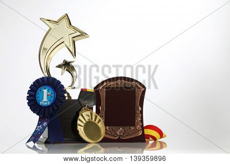 First place award rosette and trophy on the white background
