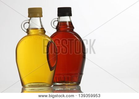 agave syrup and maple syrup on the white background