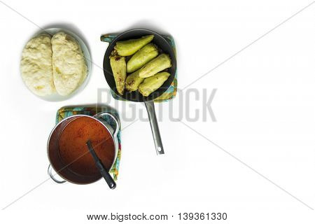 Green Peppers stuffed with spelt hails and meat with homemade dumplings and tomato sauce. Flat lay food isolated on white background.