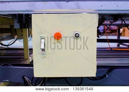 Emergency button on the door of control box.