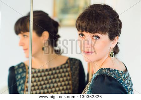 Beautiful girl in the reflection in the mirror