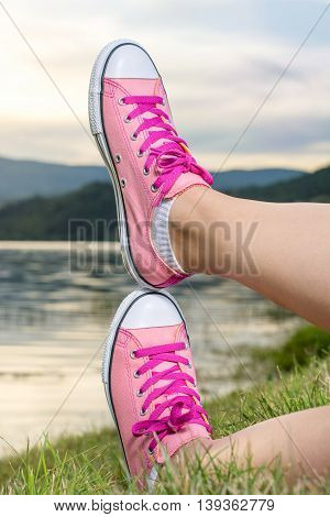 Enjoying By Lake. Woman Wearing Pink Sneakers