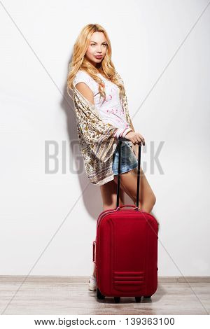 Portrait Of A Young Woman Standing With Pink Travel Suitcase