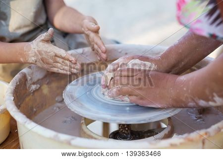 Hands Of Young Potter, Creating An Earthen Jar On The Circle, Close-up
