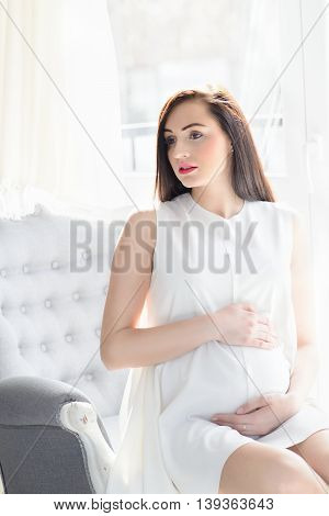 Beautiful Young Brunette Pregnant Woman In White Dress
