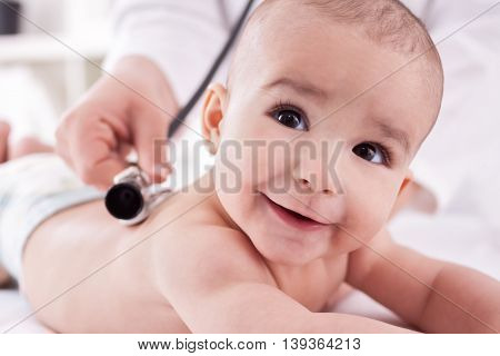 Smiling Happy Baby With Doctor Pediatrician