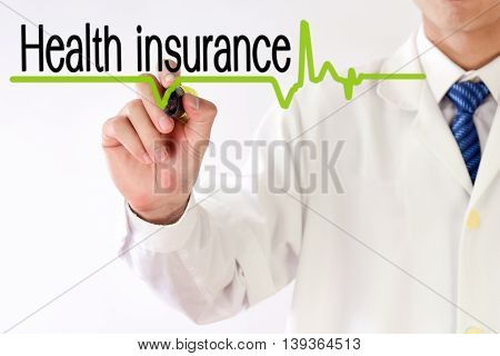 Blurred Doctor writing Health insurance text concept