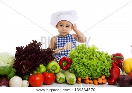 Little Boy In Chef's Hat With Scoop And Cooking Vegetables