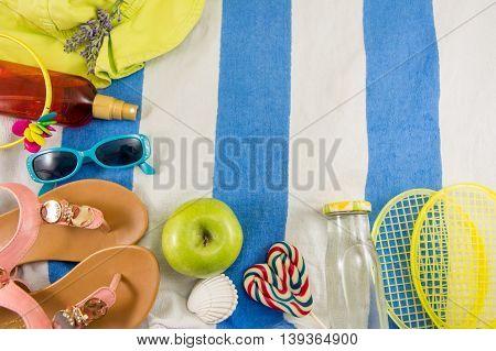Summer Accessories On Beach Towel