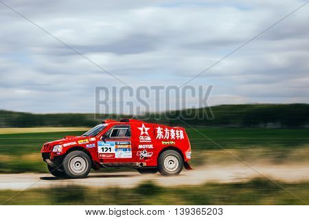 Filimonovo Russia - July 11 2016: motion blur rally car Chinese team rides on road during Silk way rally