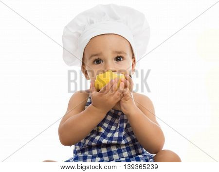 Adorable Baby With Chef's Cap Eating Pear