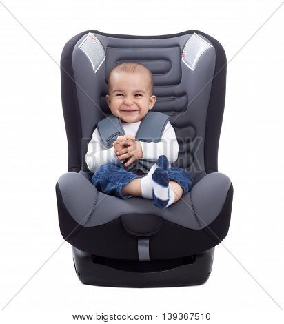 Funny Cute Baby Sitting In A Car Seat, Isolated