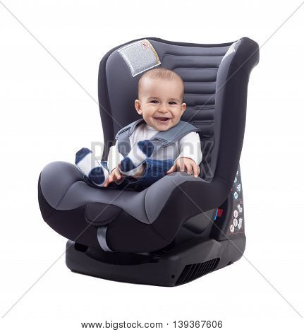 Smiling Happy Adorable Baby Sitting In Car Seat